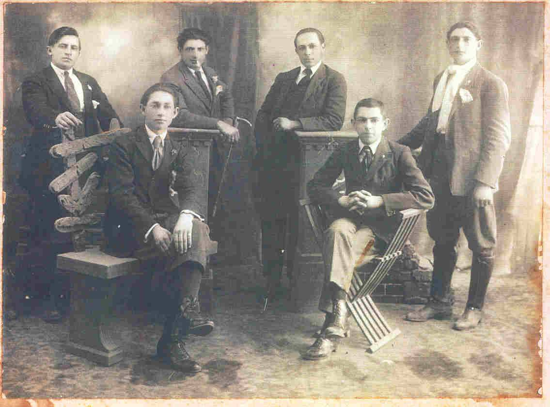 Six persons, photograph unknown